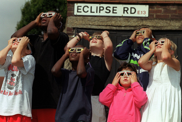 File photo of children from the Eclipse Road area of London viewing the 1999 solar eclipse.