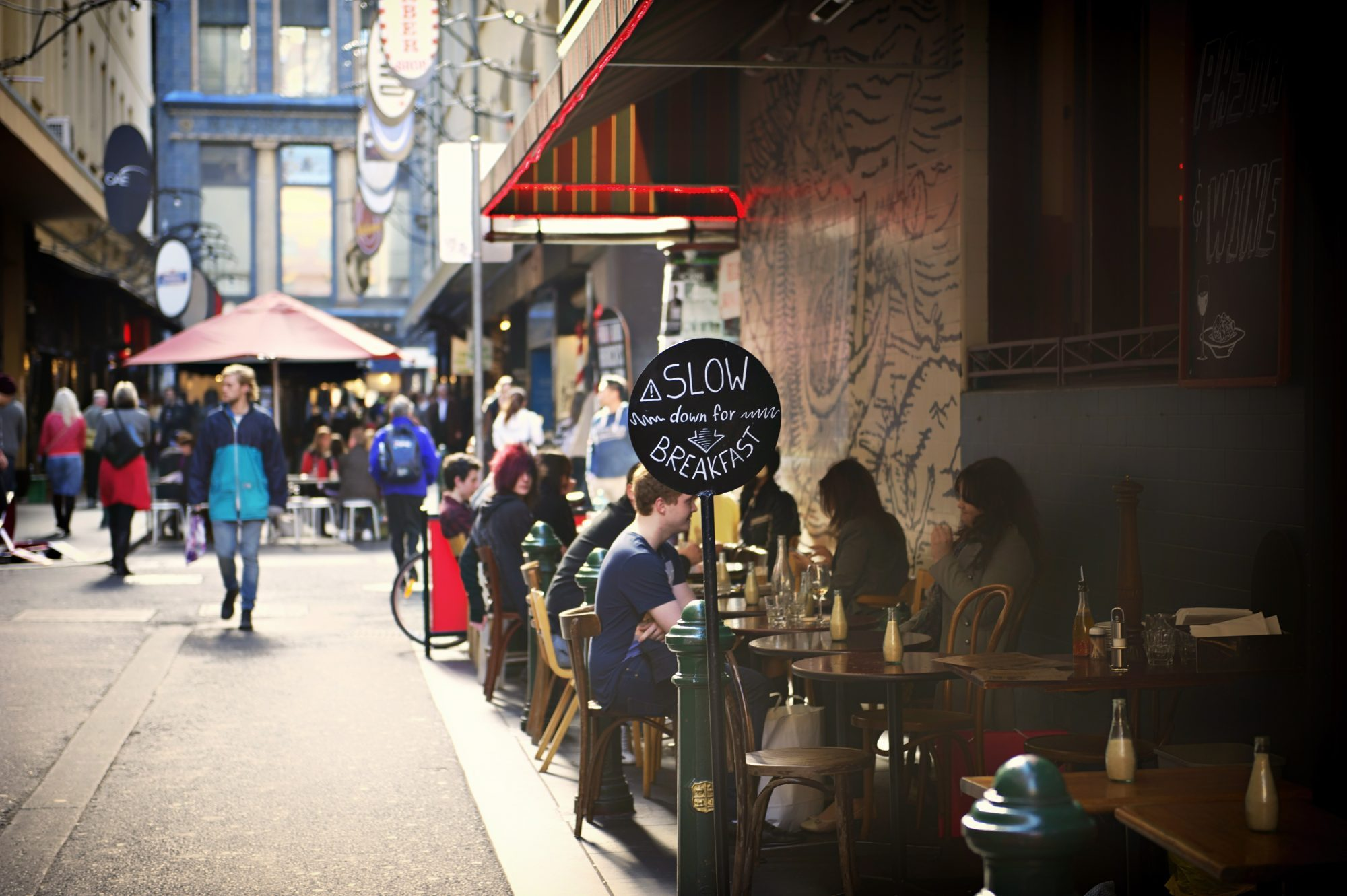 People eating breakfast in Melbourne's iconic inner-city Degraves Street.