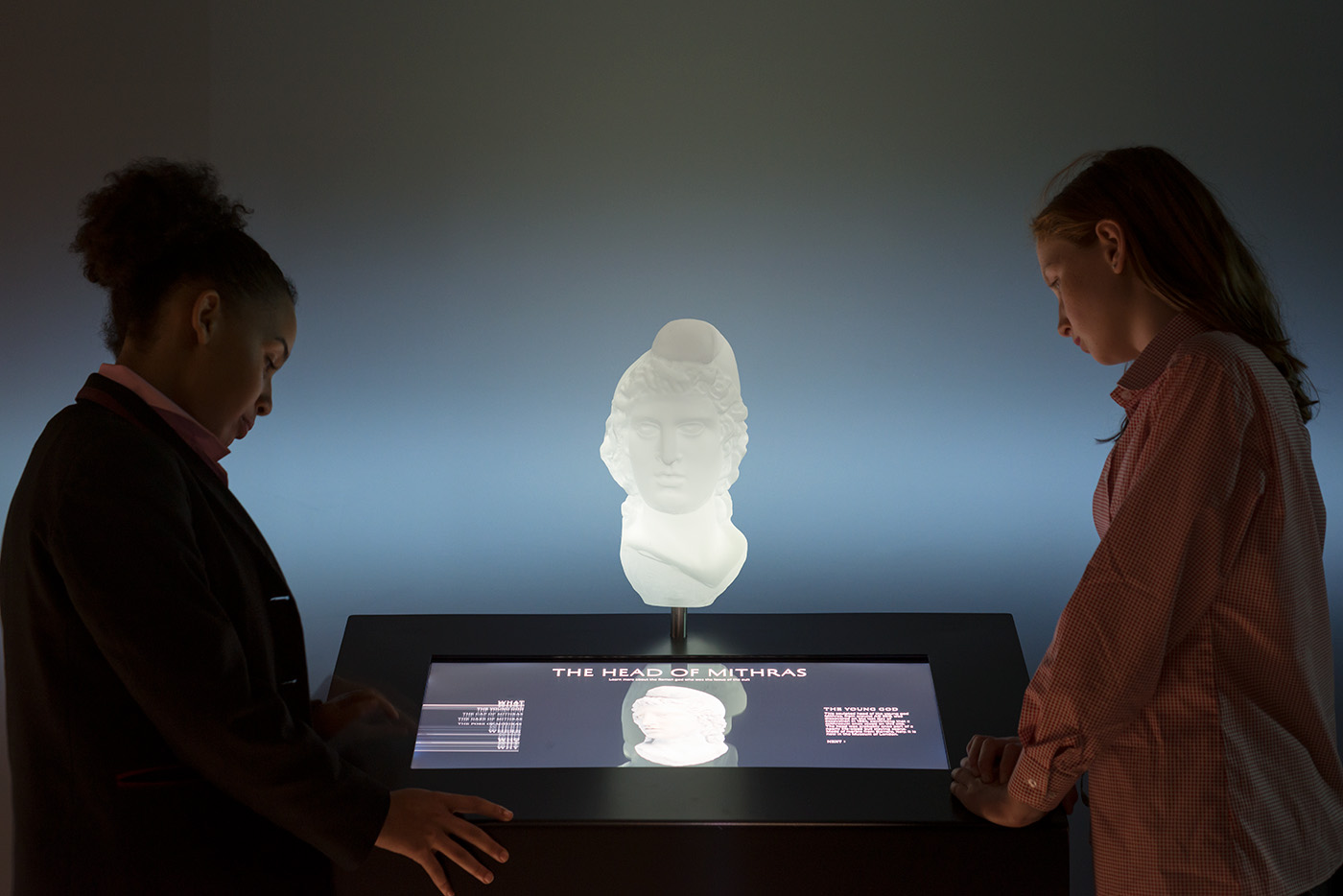 Interactive kiosks on the mezzanine level of London Mithraeum Bloomberg SPACE invite visitors to learn more about the rituals and beliefs behind the cult of Mithras.