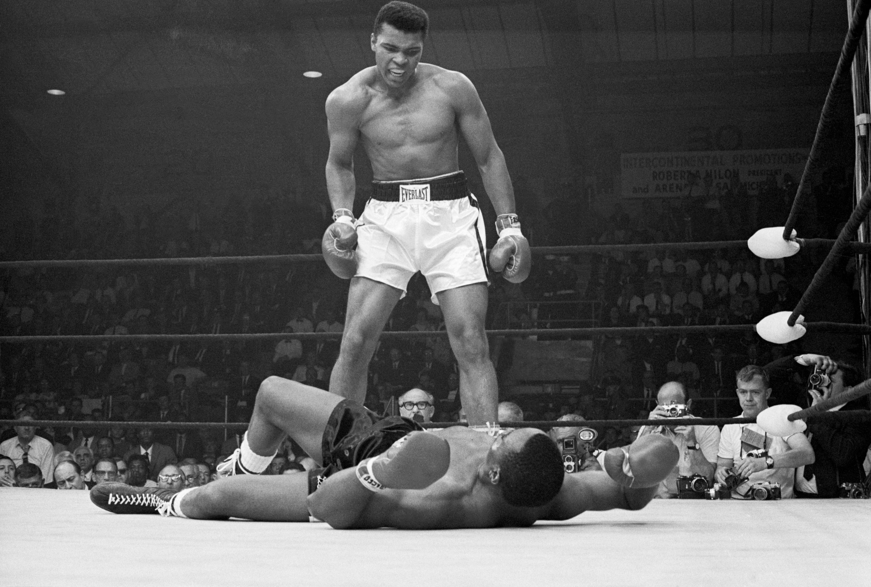 Ali taunts Sonny Liston during their fight in Maine in May, 1965