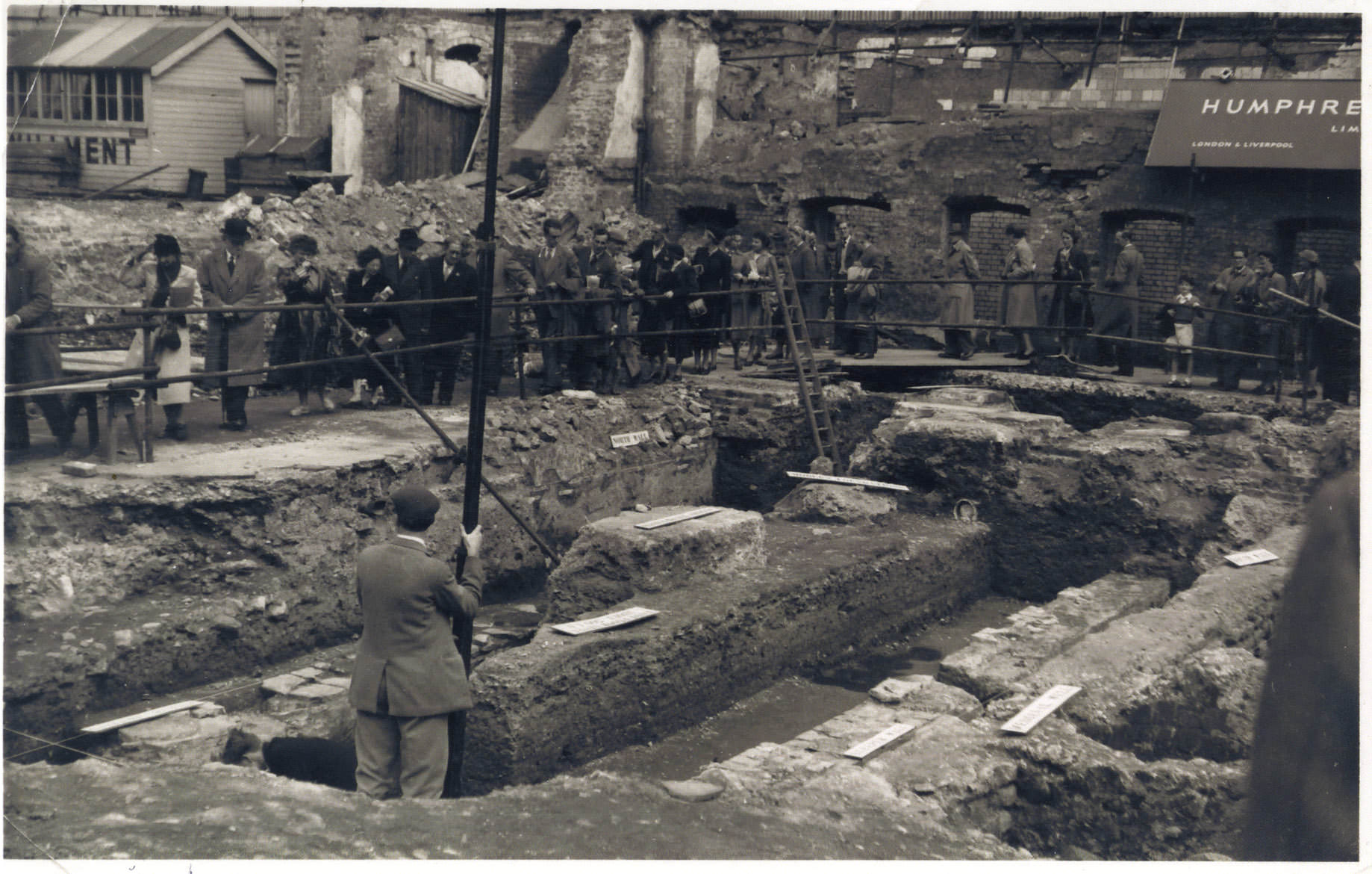 A photograph of the excavation of the Temple of Mithras dig from 1954.