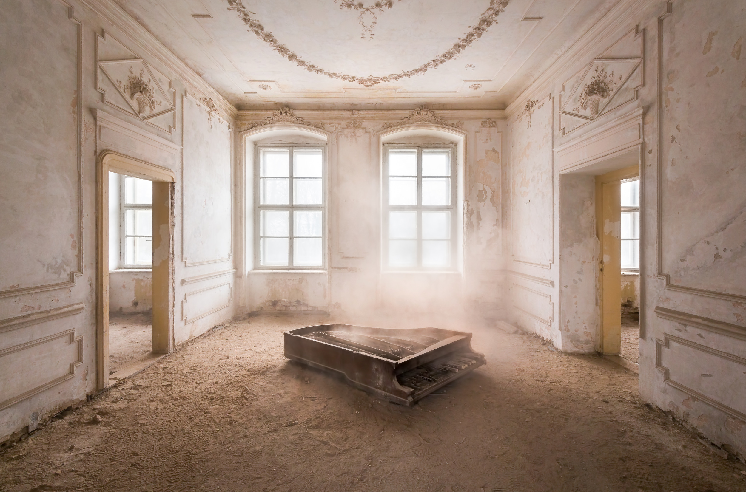 A piano in a dust covered palace somewhere in Poland.