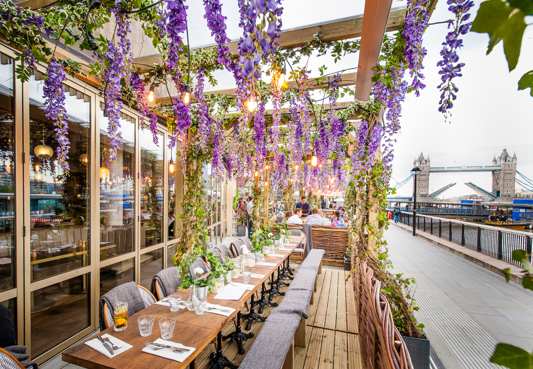 A Coppa Club cabana with wisteria and roses