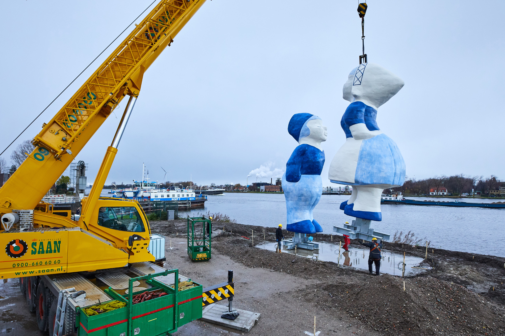 The sculpture is lowered into place by crane