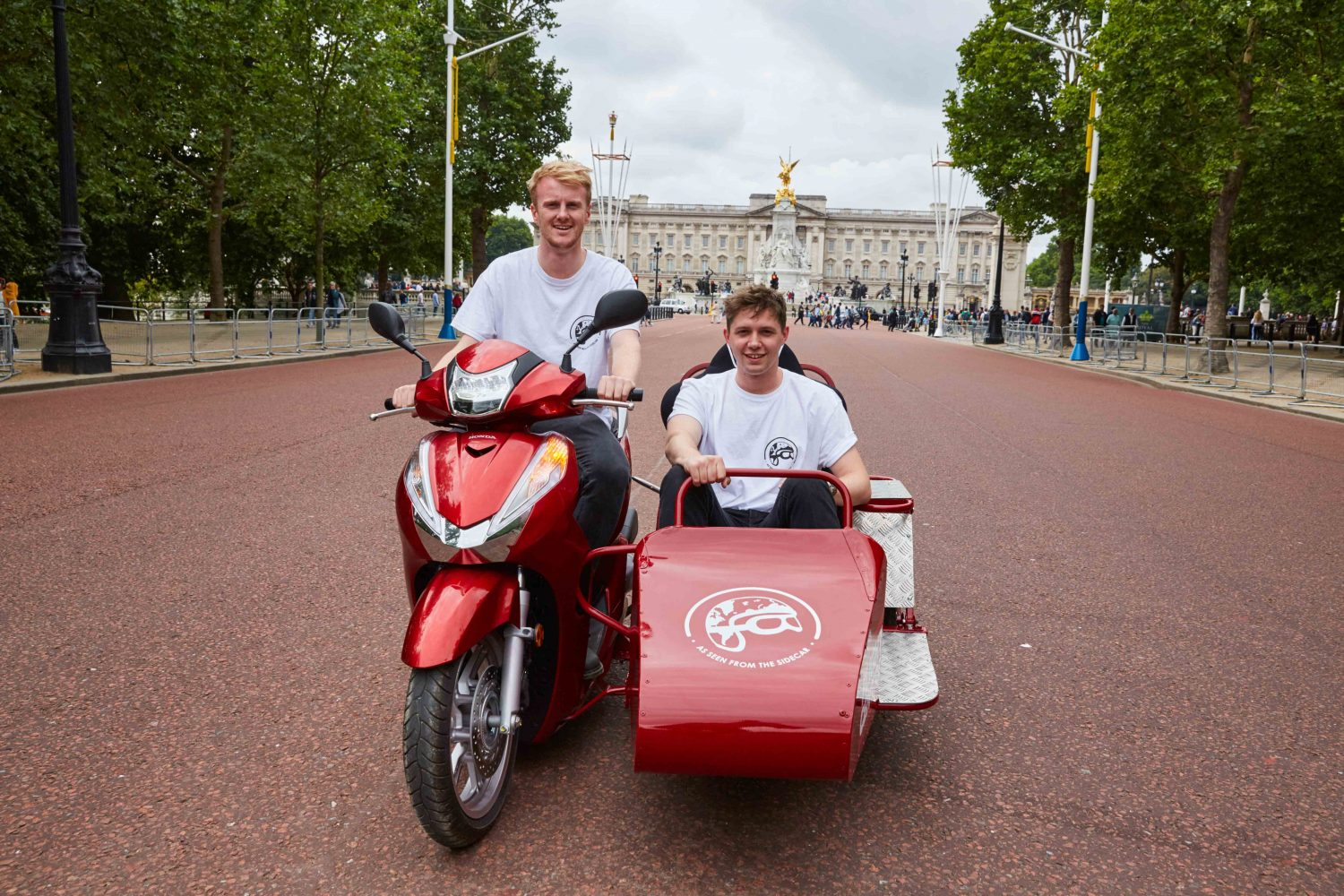 Travel consultants plan round the world trip on a scooter