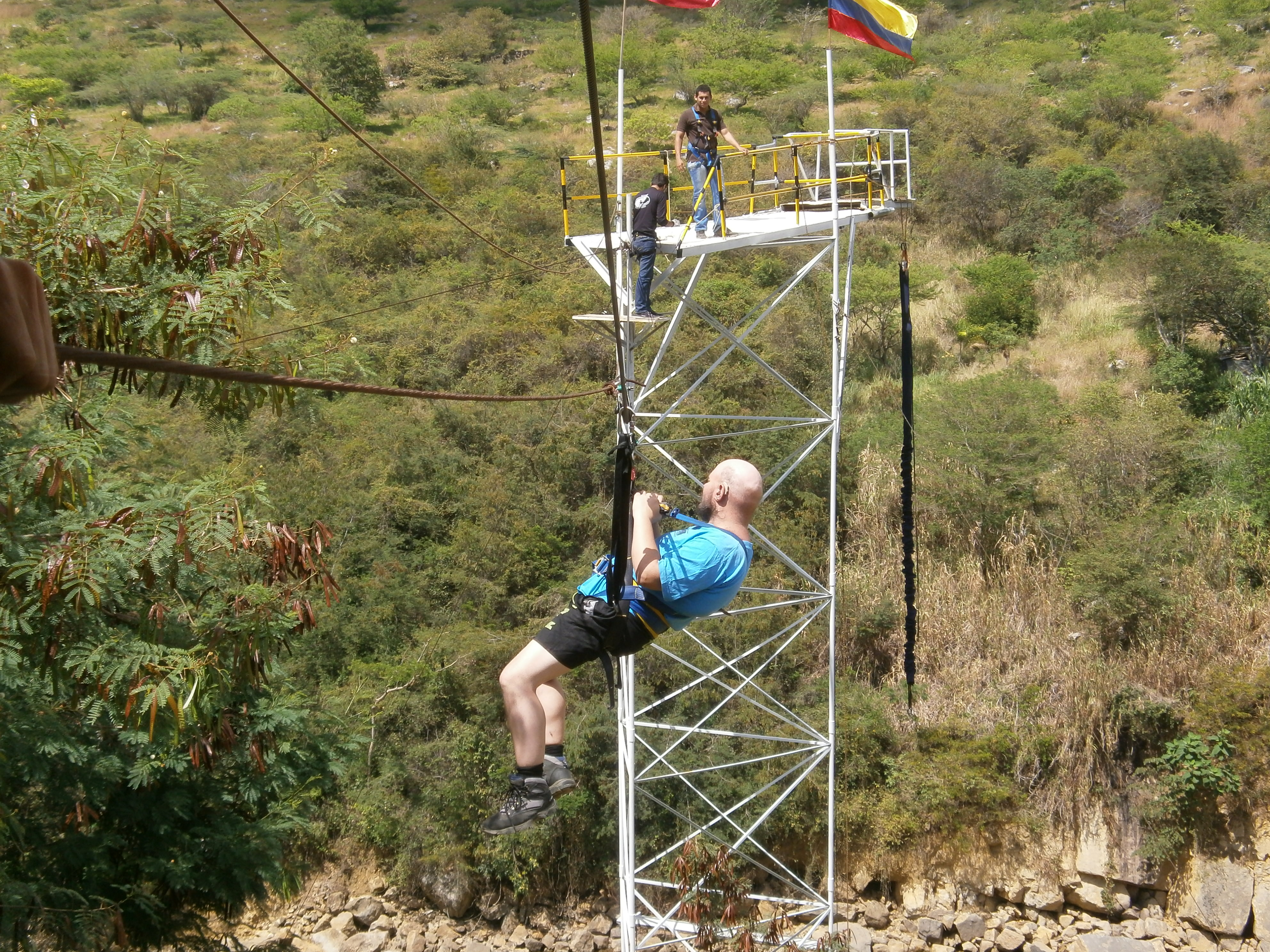 Tony Sliding along a zip wire to a bungee platform in San Gil, Colombia.