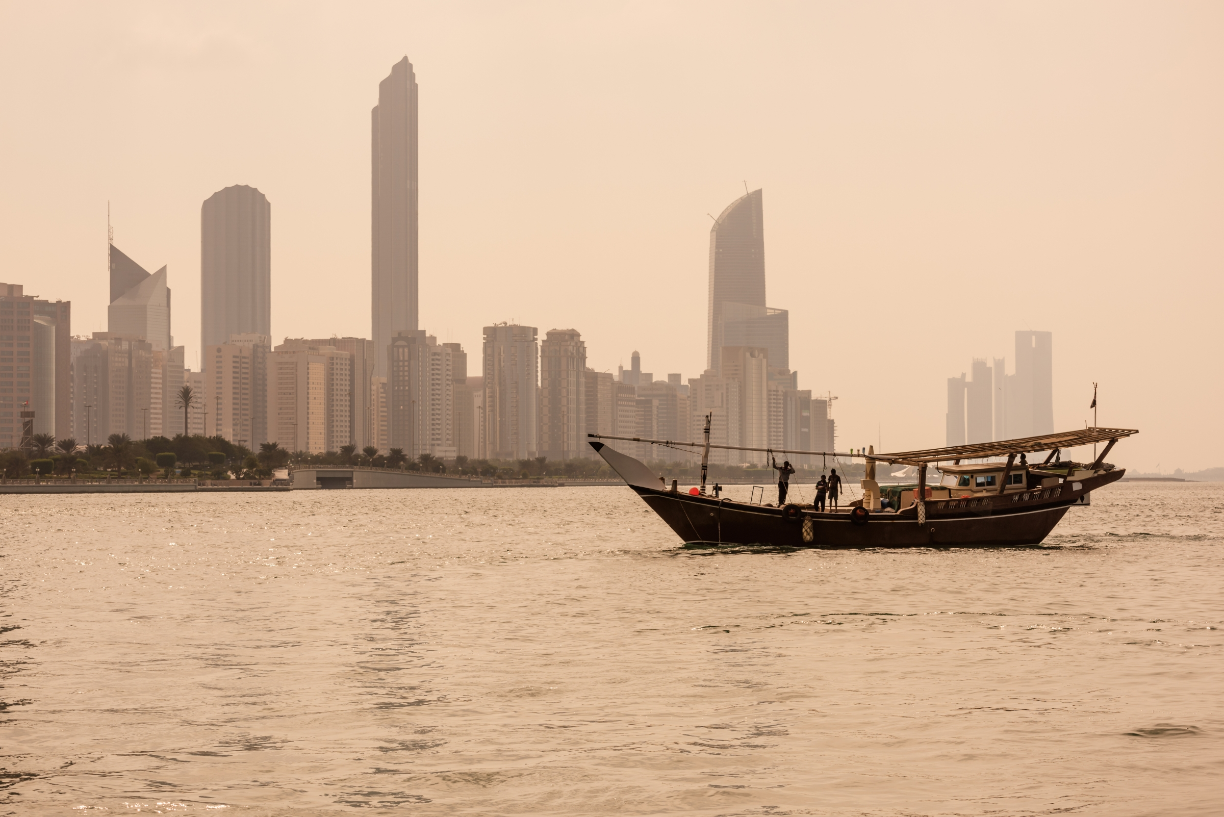 The Abu Dhabi skyline with an old fishing boat.