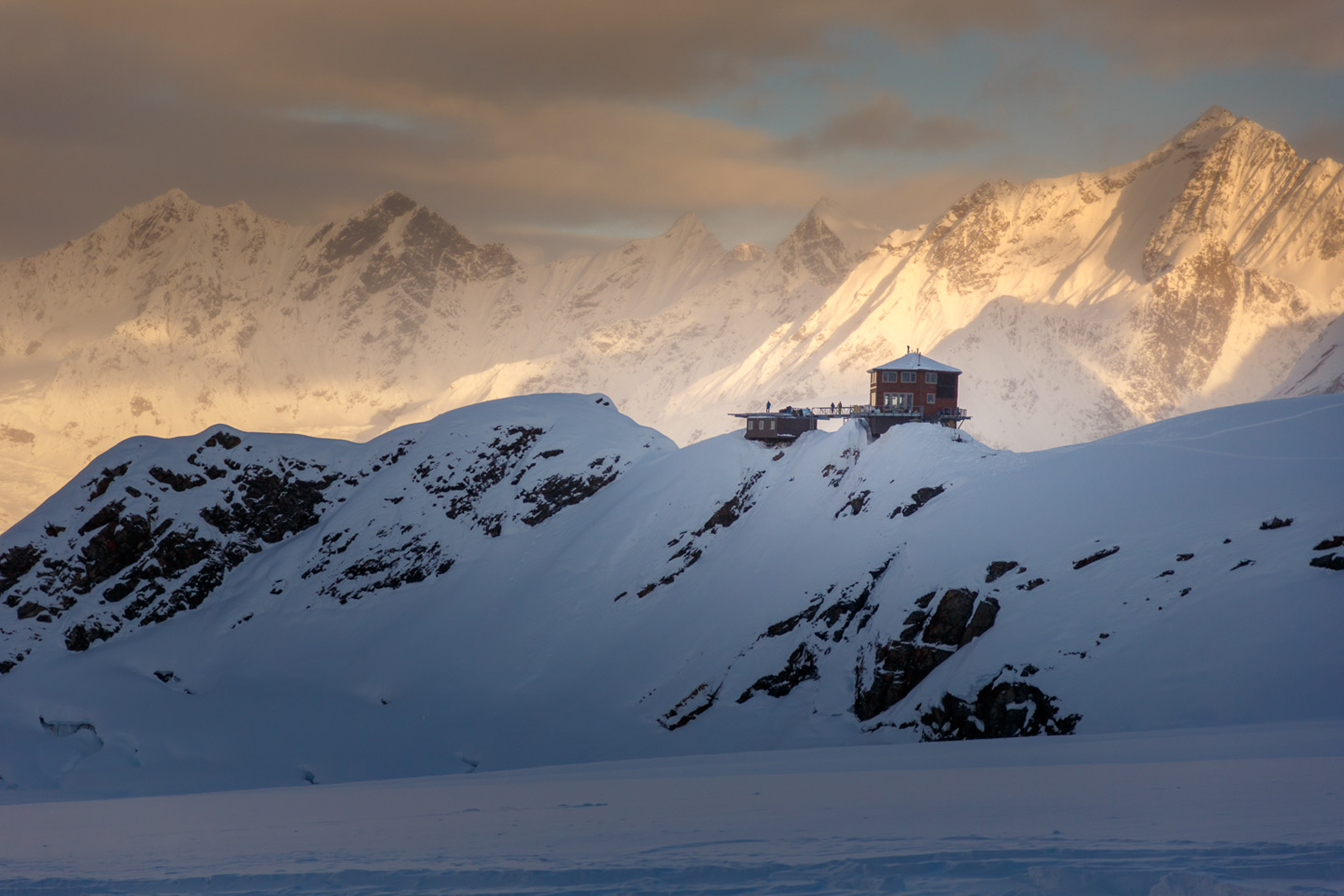 The chalet is built on an ancient nunatak on the Ruth Glacier.