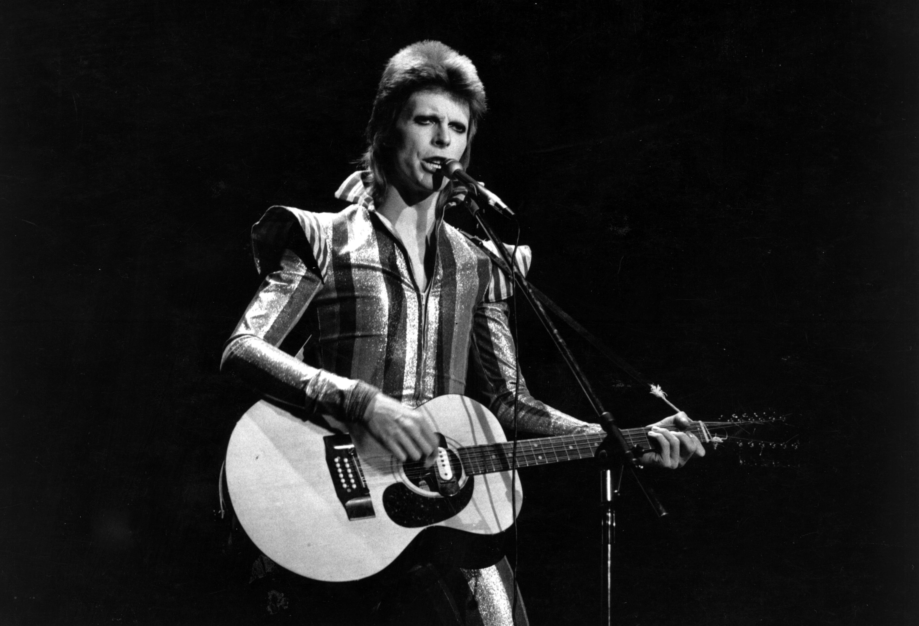 David Bowie performs his final concert as Ziggy Stardust at the Hammersmith Odeon, London on 3 July 1973.