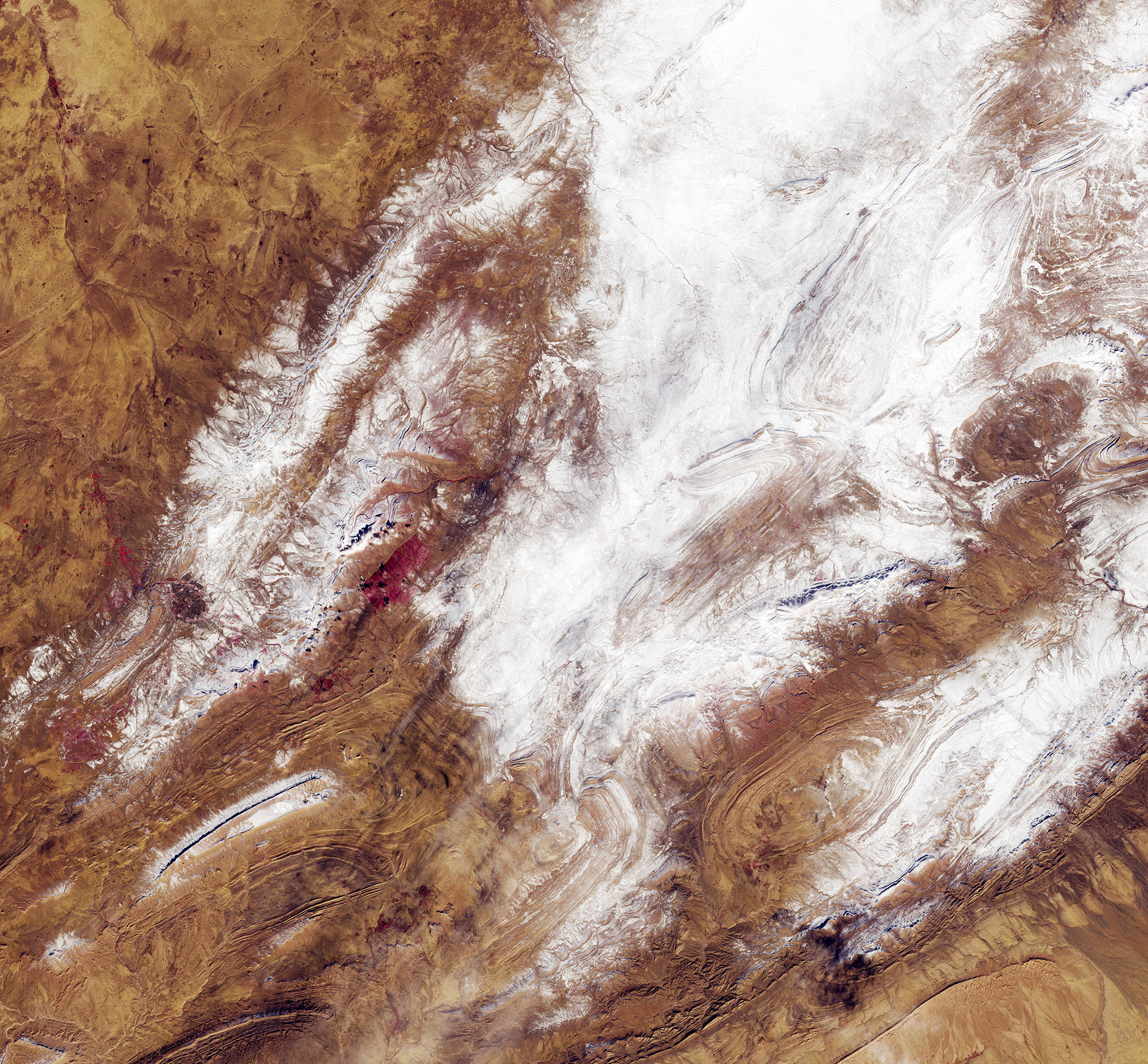 The image of the Sahara Desert dusted in snow, as captured by the Copernicus Sentinel-2 mission.