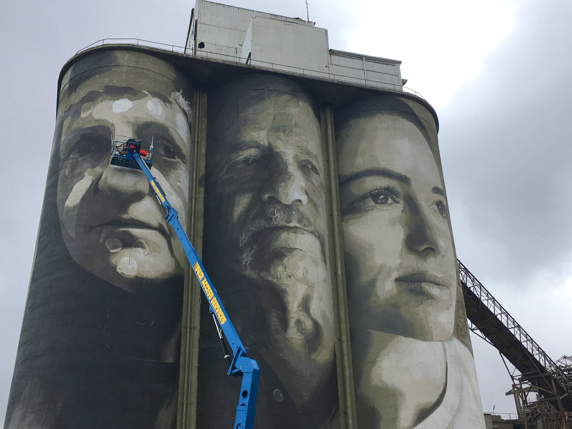 Street artist Rone working on the silo in Geelong