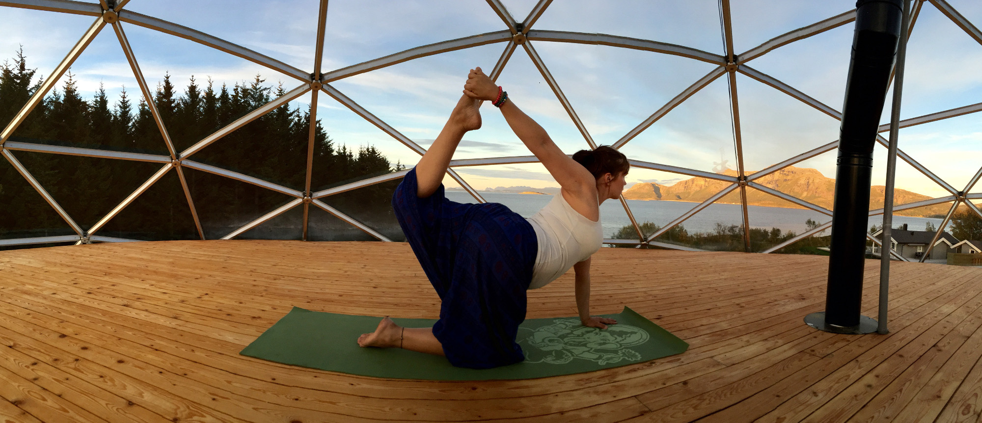 Practising yoga against a stunning backdrop