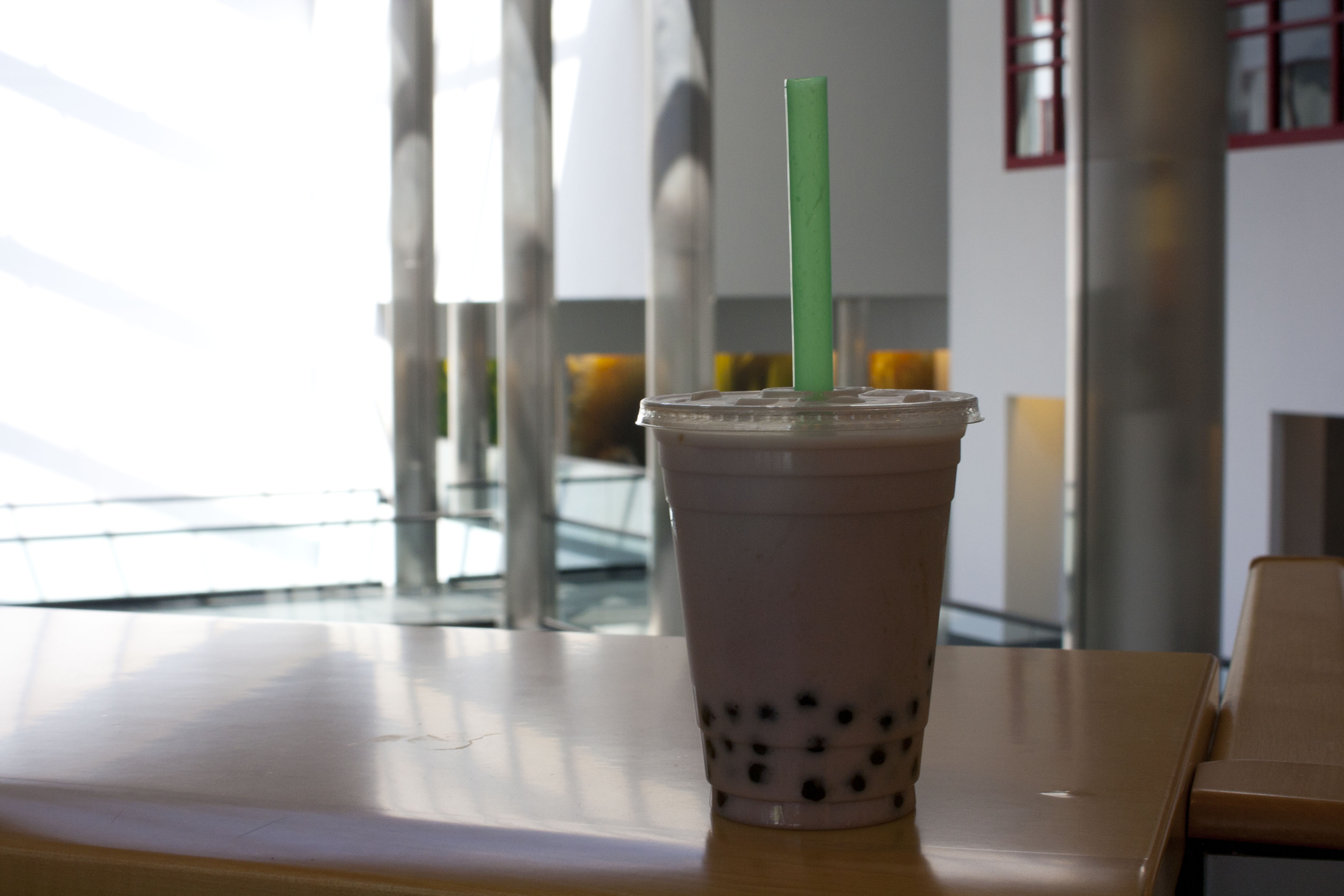 Bubble tea, made with small, chewy tapioca balls that are sucked up through a straw.