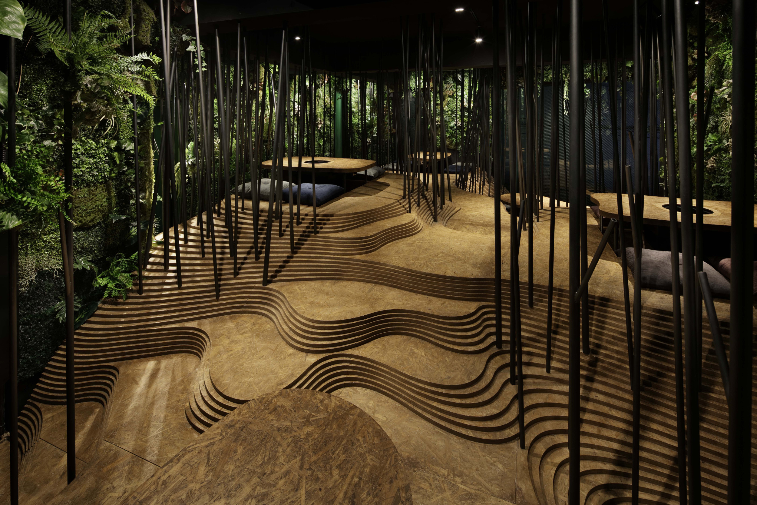 The upper floor of the restaurant is designed to make customers feel as if they are eating in a forest.