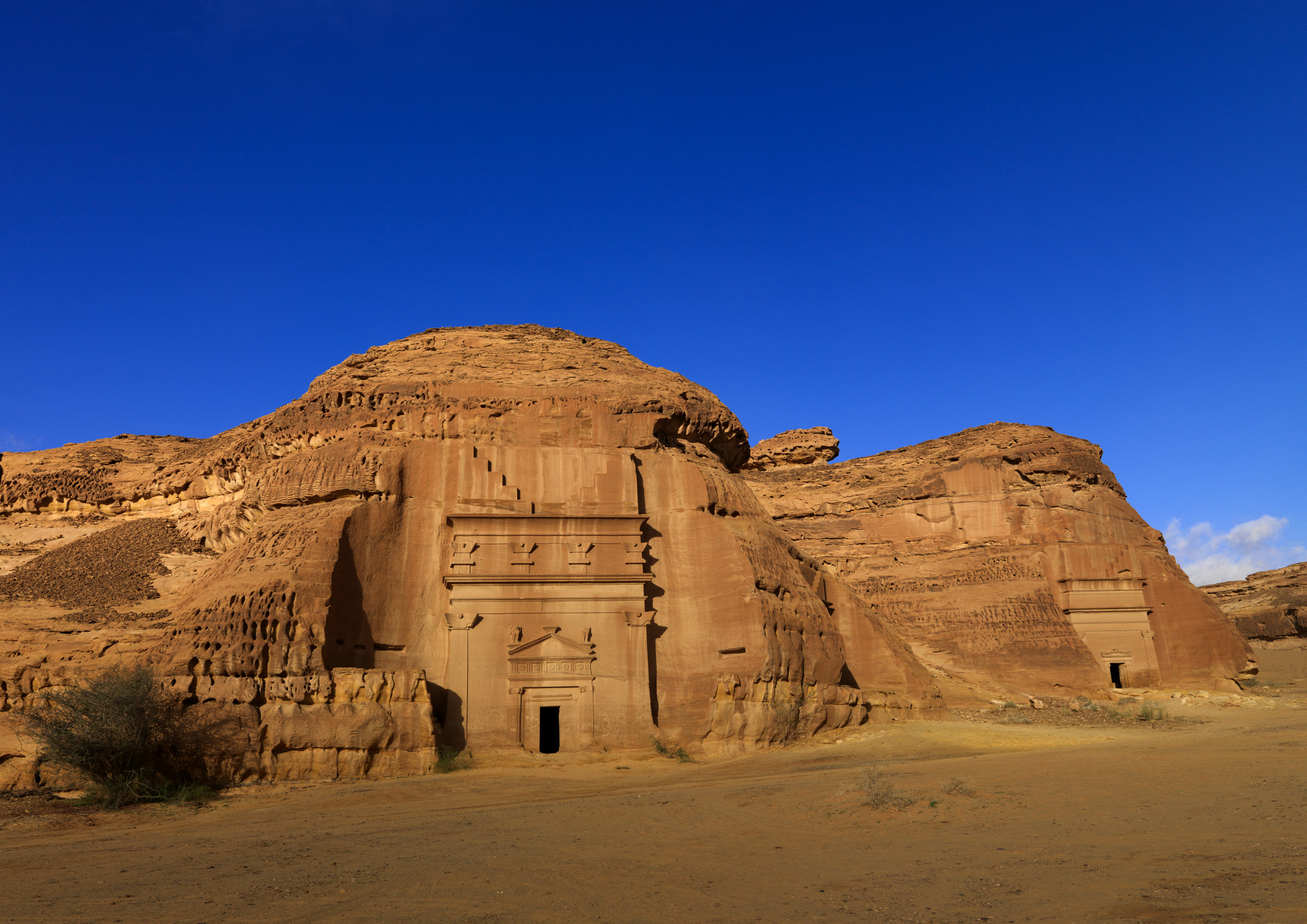 Madain Saleh in Saudi Arabia, a sister city to Jordan's Petra. The UNESCO World Heritage site is located in the Al-Ula sector, within the Al Madinah Region of Saudi Arabia.