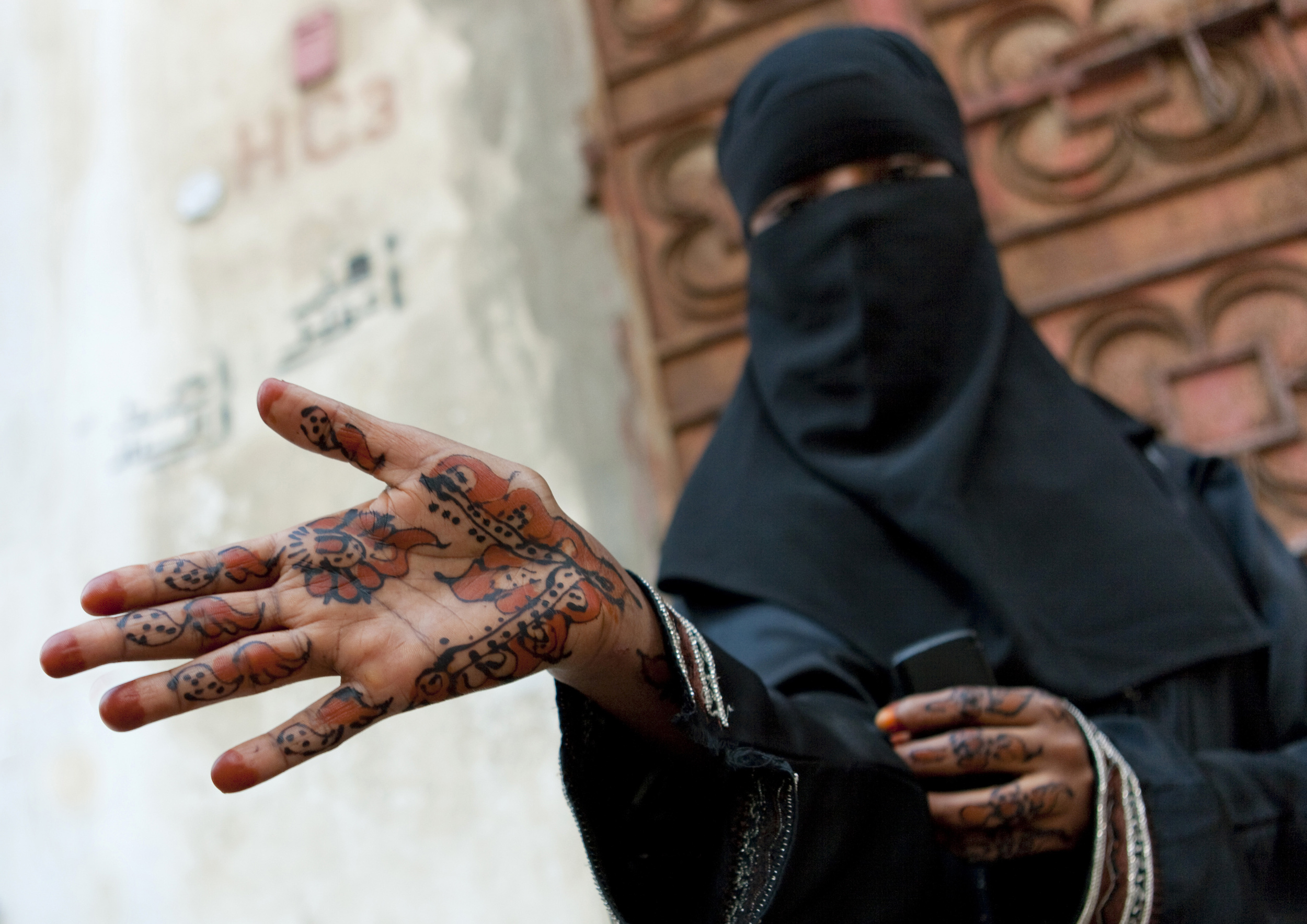 A Somali woman shows a henna design on her hand. The photographer said that during his time there, he rarely saw women out in public.
