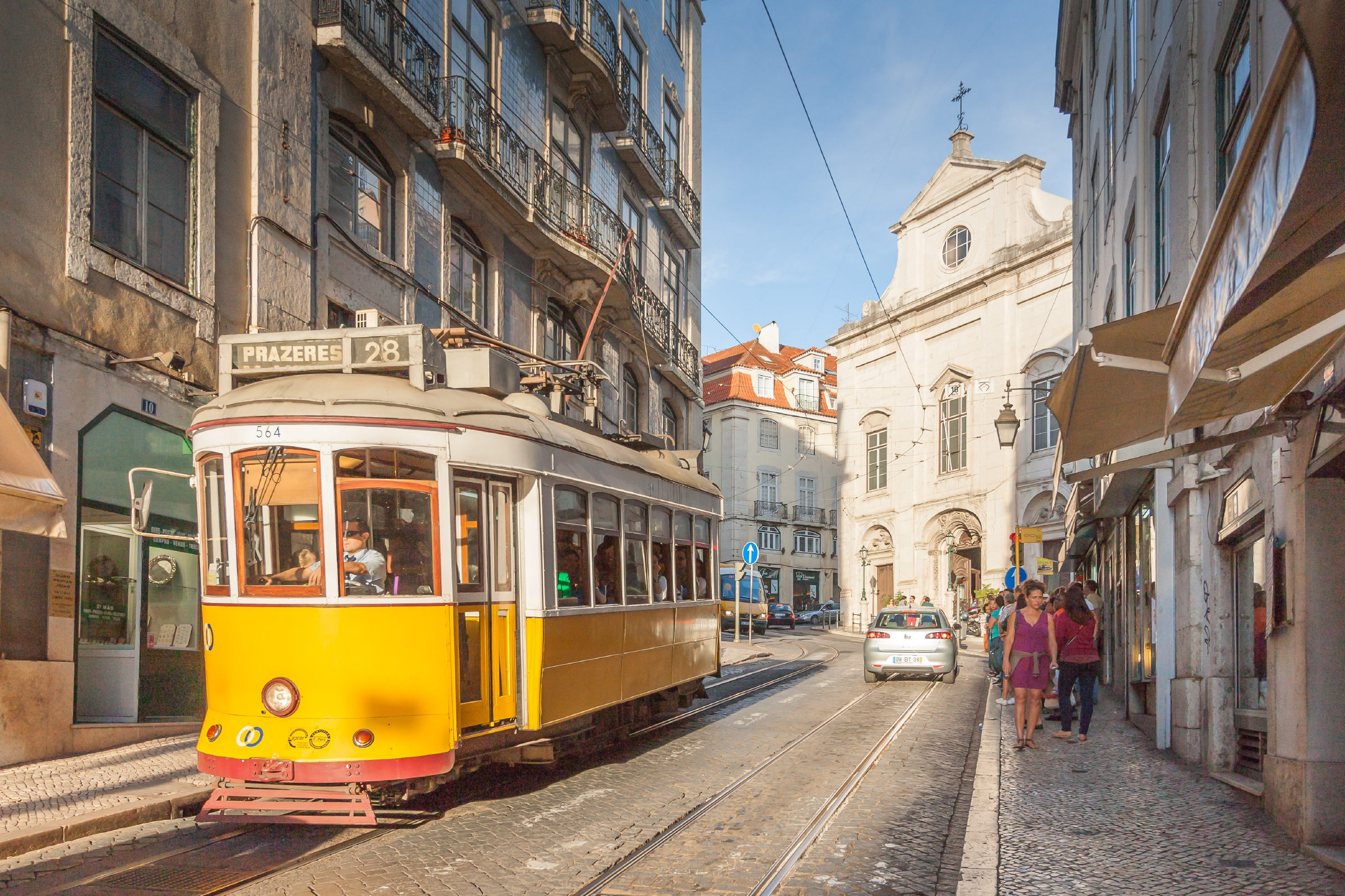 One of Lisbon's classic trams travels through the streets.
