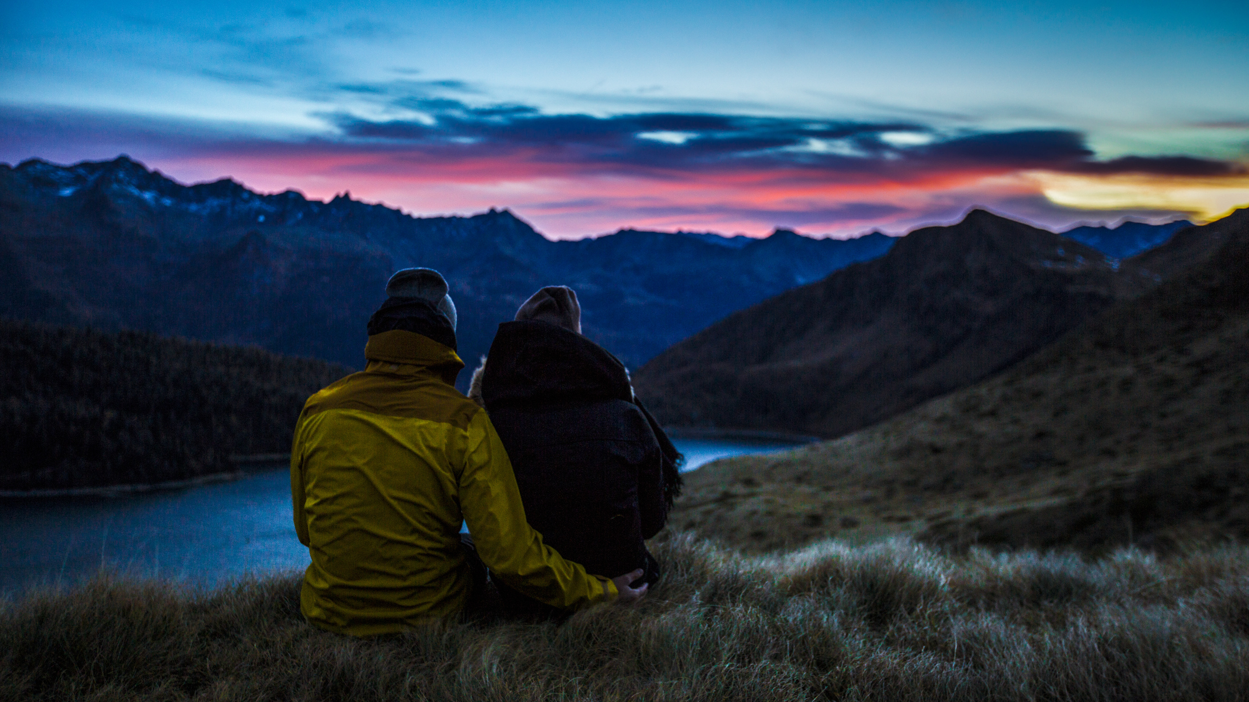 Couple Hiking at sunset in the mountains