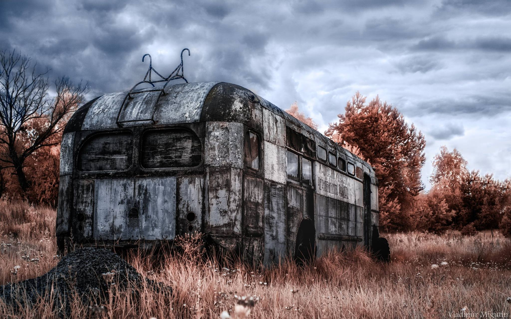 An abandoned vehicle left rusting.