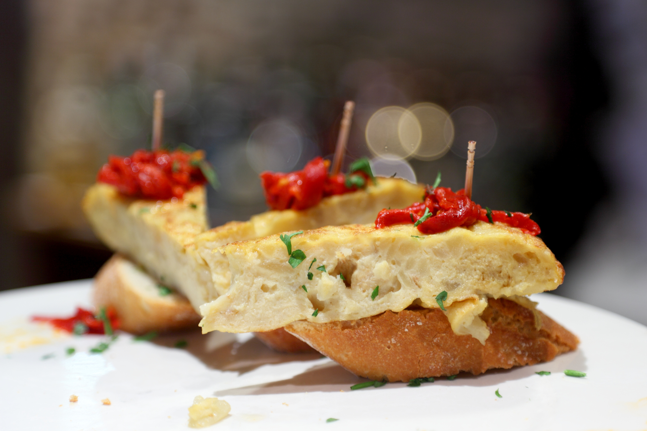Pincho (Spanish; literally, thorn or spike) or pintxo (Basque) name of certain snacks typically eaten in bars, traditional in northern Spain and especially popular in Basque country.